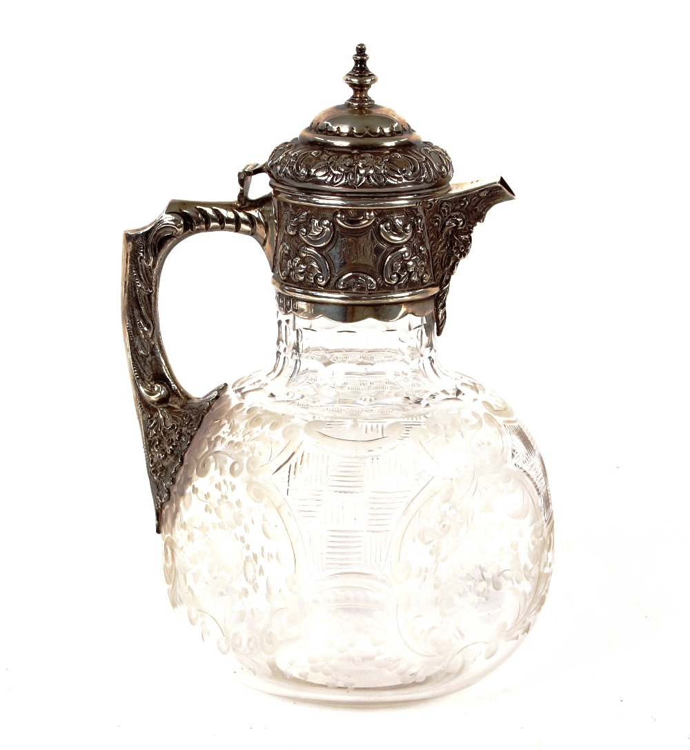 A late Victorian cut glass and silver mounted claret jug,Hallmarked for London 1899, the body