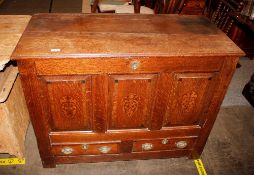 An 18th Century oak coffer,having inlaid triple panel front and two drawers below, 108cm wide