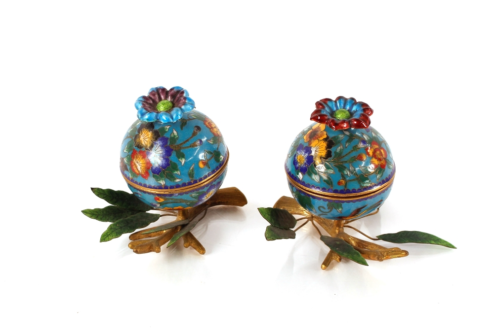 A pair of Chinese enamel and Ormolu mounted pots and covers,of globular form with leaf and branch