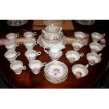 An 18th Centurytea set,in the Rockingham style having painted foliate decoration within gilt