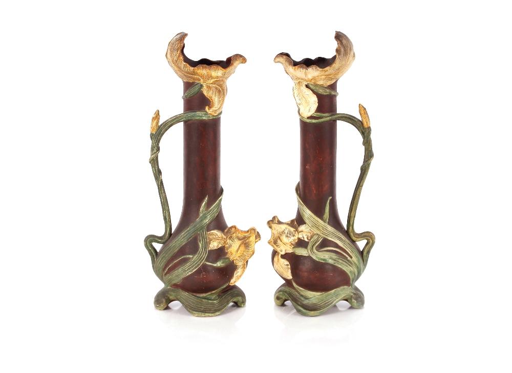 A pair of Art Nouveau amphora type Austrian iris ewers,having scrolled handles, 51cm high