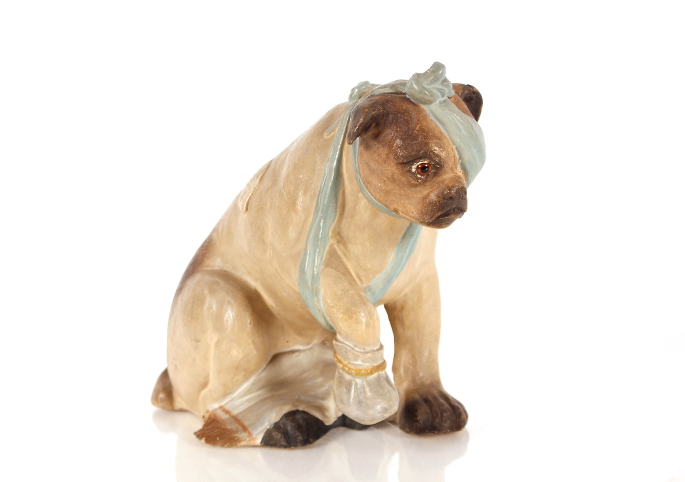 """An unusual Bretby pottery figure, """"After The Battle"""" depicting a bandaged dog, 23cm high"""
