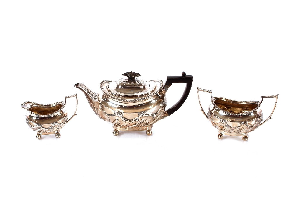 A late Victoriansilver three piece tea set,having gadrooned borders and raised foliate decoration,