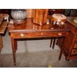 A 19th Century mahogany fold over tea table,fitted with a single drawer raised on tapering supports