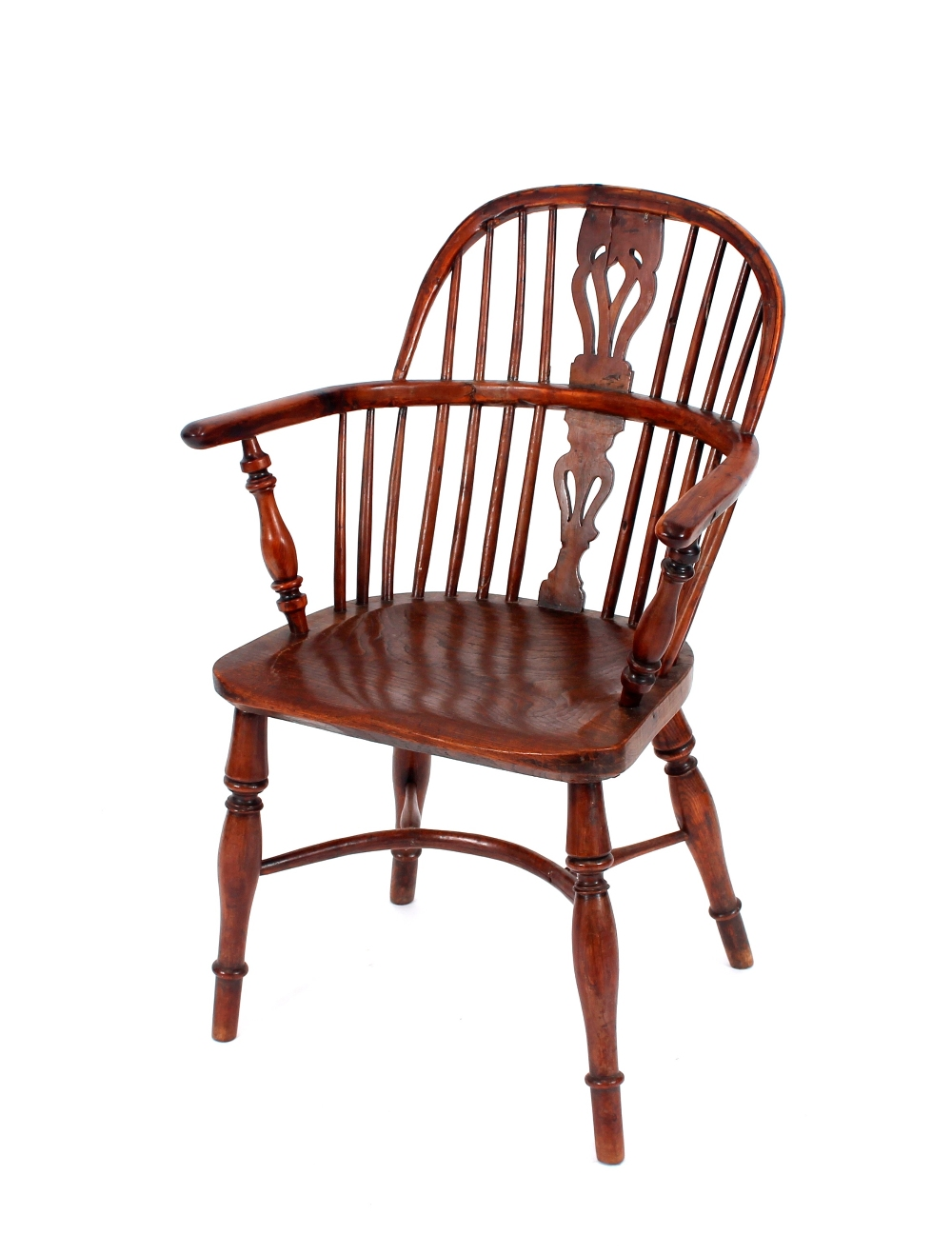 An early 19th Century yew wood and elm stick back Windsor chair,having shaped seat raised on