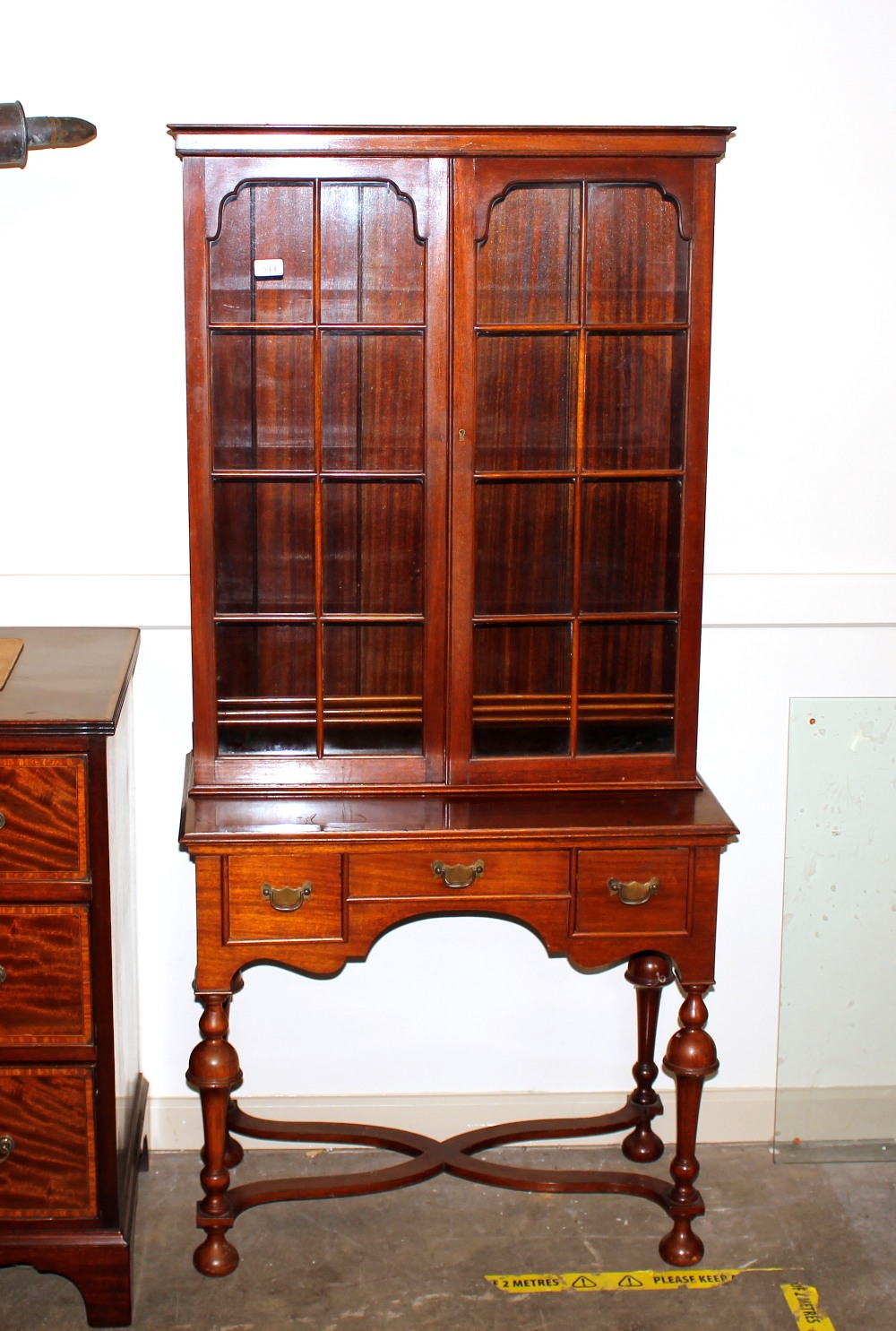 A 19th Century mahogany bookcase on stand,the upper section fitted adjustable shelves enclosed by