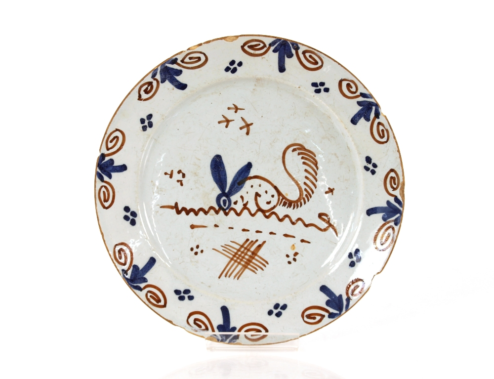 A rare early 18th Century English Delftware dish,painted with a stylised hare with a squirrels