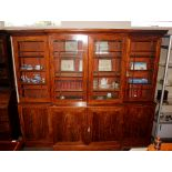 A Victorianmahoganybreak front bookcase,the upper adjustable shelves enclosed by four