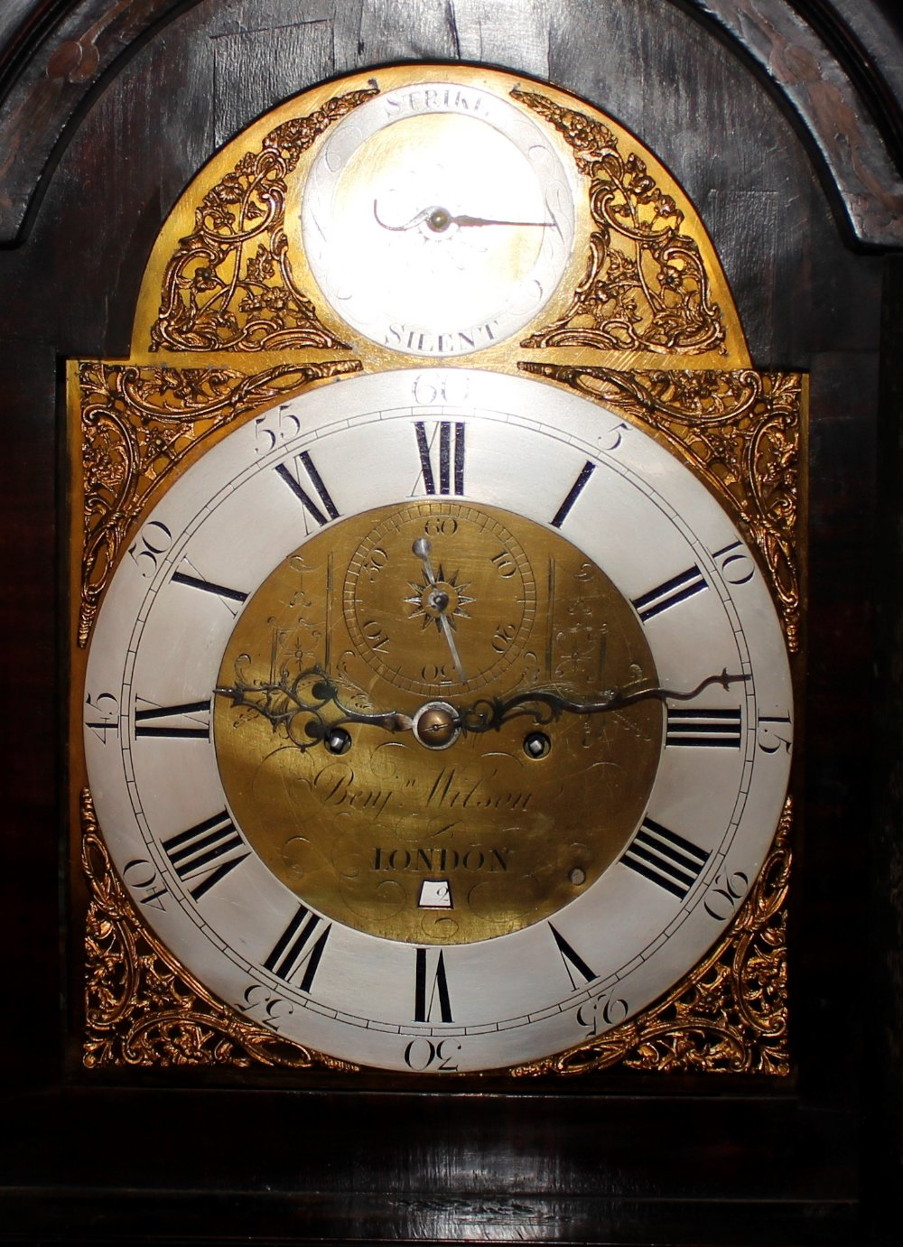 A George III and later marquetry inlaid mahogany long case clock,the domed hood with three brass