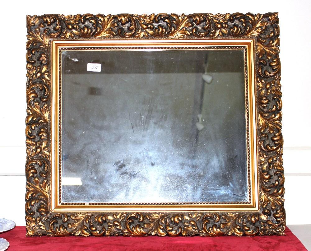 An antique gilt framed wall mirror,having foliate scroll decoration, 61cm x 70cm