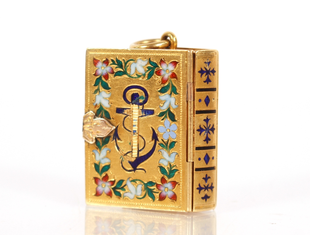 A yellow metal and enamel decorated mourning pendant,in the form of a Bible, containing hair - Image 2 of 3