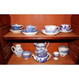A blue and white willow pattern Ashworth Bros. bullet shaped teapot;a Chinese pattern cup and