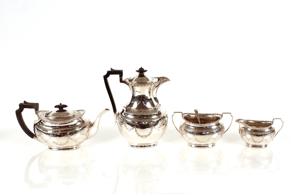 A silver matched four piece tea and coffee set,by Aitken Bros. coffee pot,Sheffield1908, tea