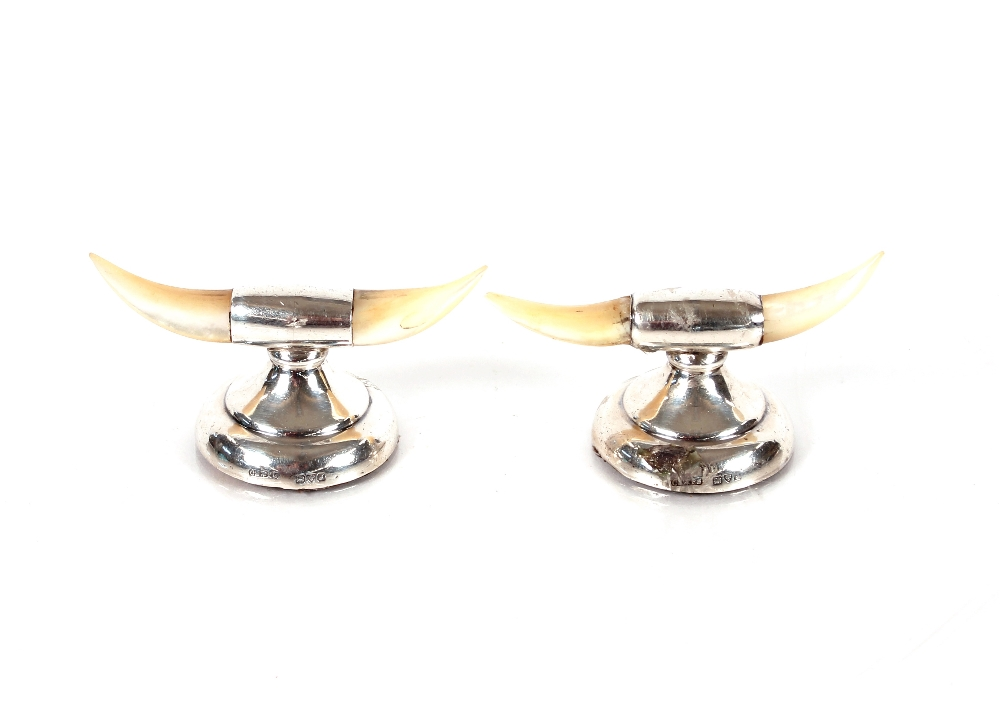 A pair of silver and mother of pearl knife rests,Chester 1909