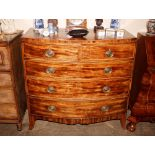 A Georgian mahogany and chequer banded bow frontchest,of two short and three long drawers raised