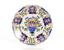 A pair of Delft plates decorated flowers,23cm dia. AF