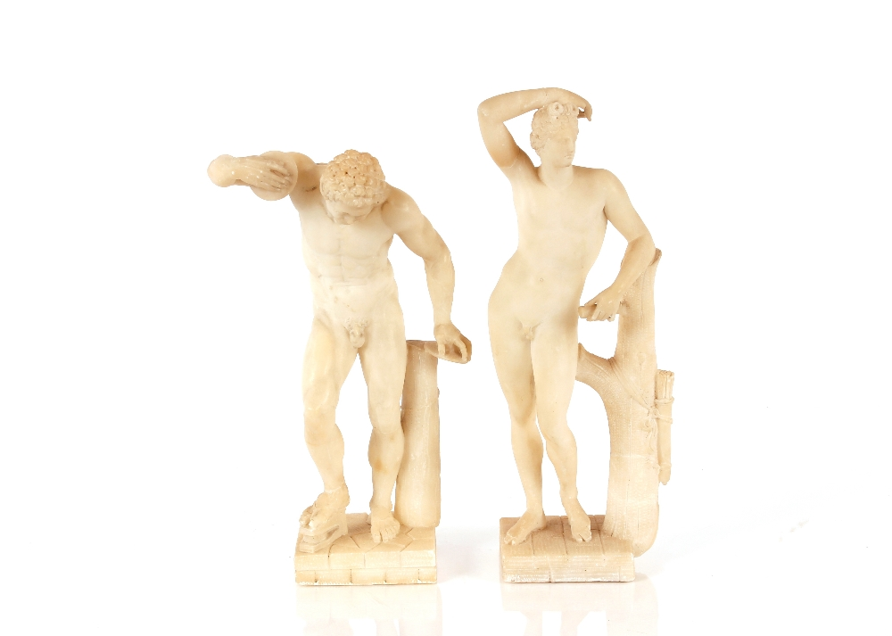 A pair of 19th Century alabaster figures,depicting athletes, 35cm high