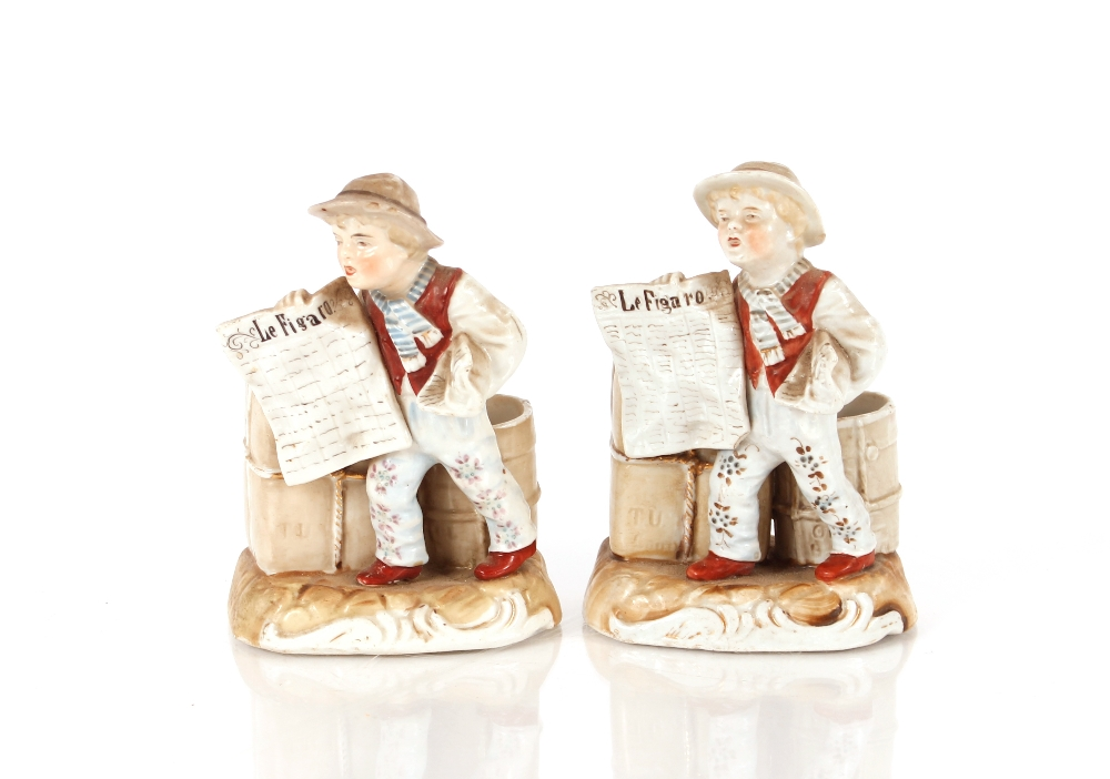A Meissen porcelain group, depicting Summer season, another of winter AF and restored, and a pair of