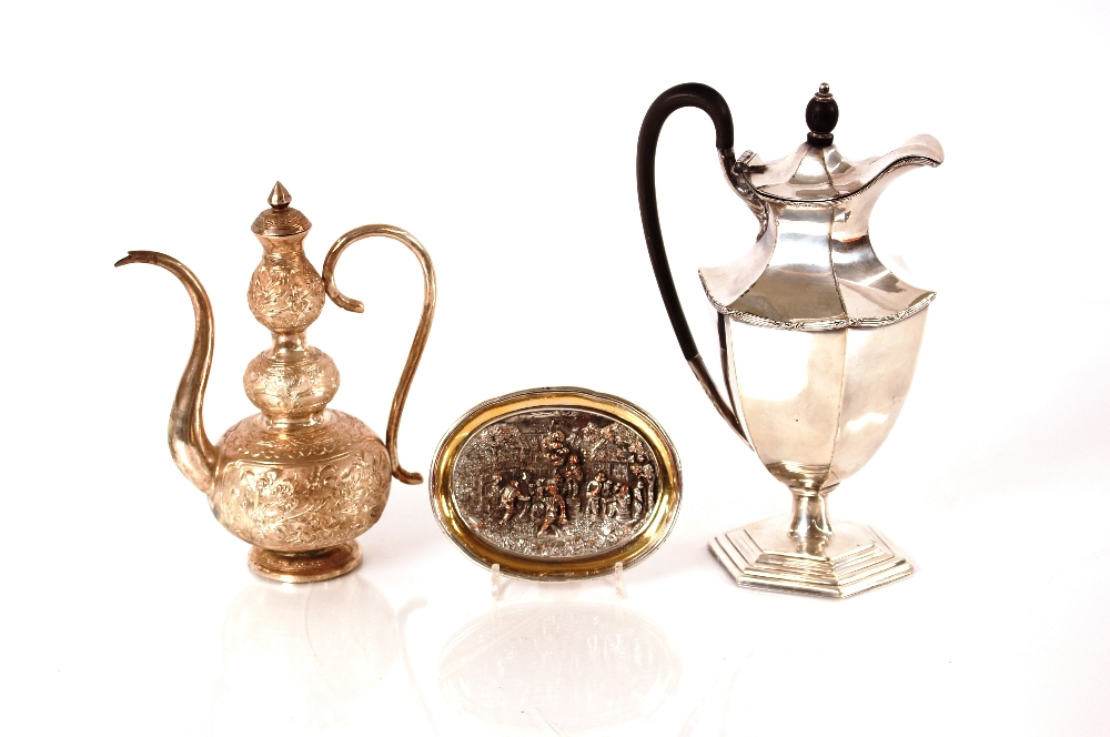 A MiddleEasternwhite metal coffee pot,of treble baluster form; a plated hot water jug; and an