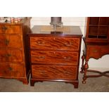 A mahogany and satinwood cross banded chest,fitted three drawers raised on bracket feet, 75cm