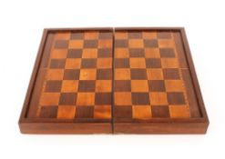 A mahogany rosewood and satinwood inlaid folding chess board,with backgammon to the interior,