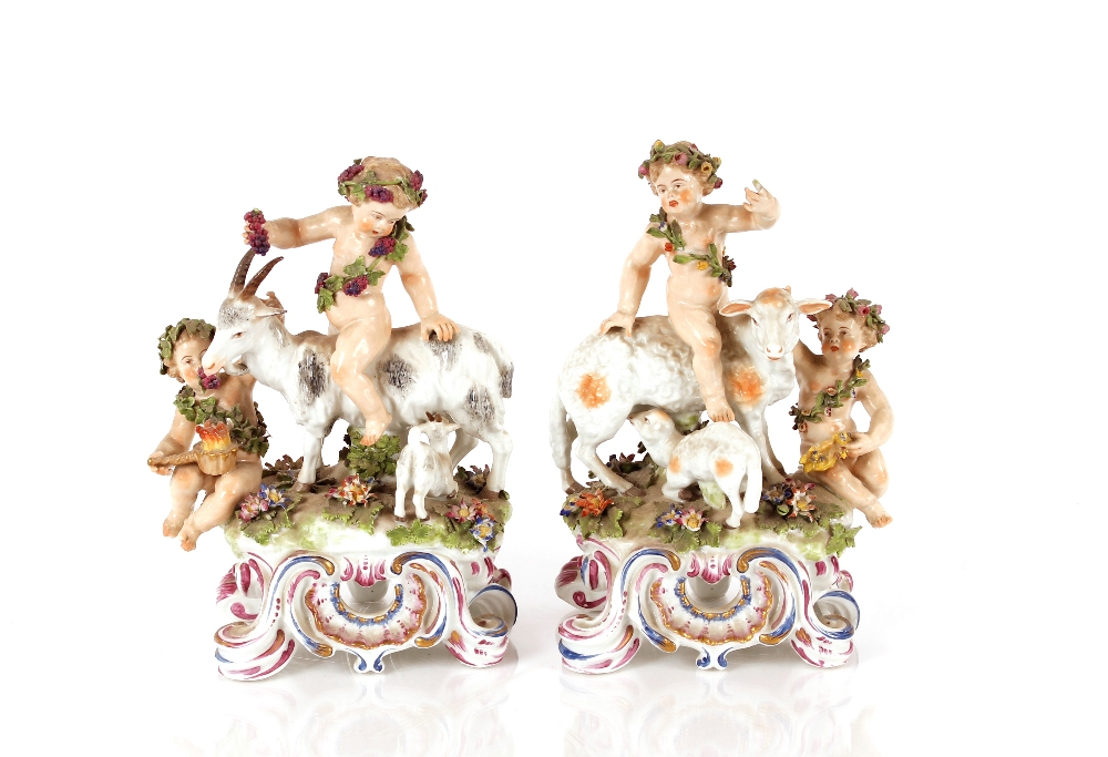 A pair of Samson porcelain figure groups, depictingfloral encrusted cherubsriding goats and sheep,