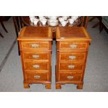 A pair of mahogany and walnut cross banded bedside chests,fitted four drawers with brass drop