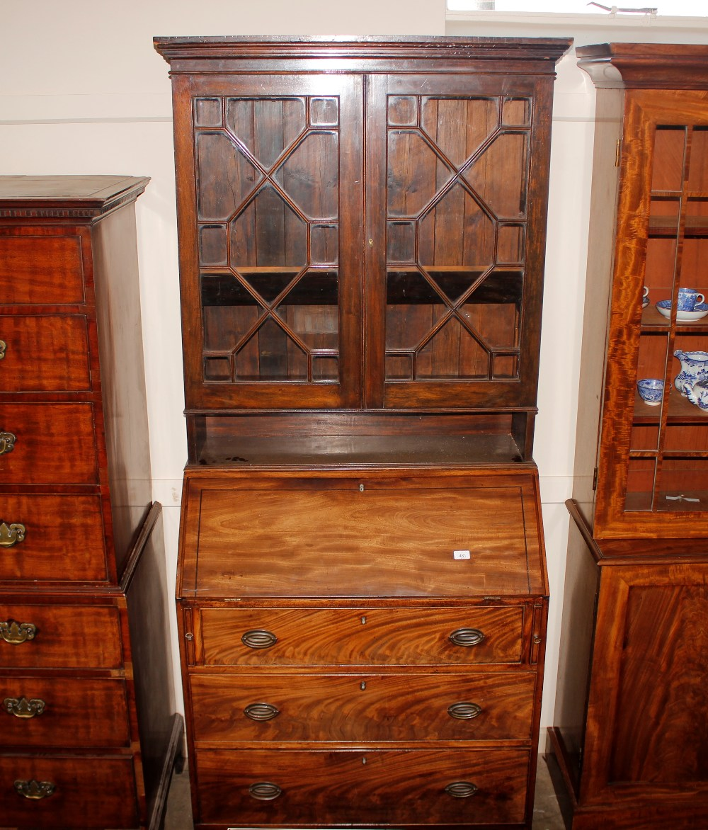 A Georgian mahogany bureau,the fall front opening to reveal an interior arrangement of drawers