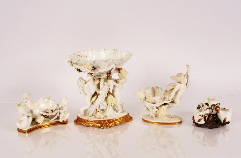 A Moore & Co. blanc de chine and gilt table centre piece,in the form of a large flower head held