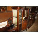 An Edwardian mahogany and inlaid mirror back chiff