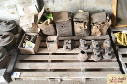 A quantity of Caterpillar D2 Spares, some unused. To include bronze bushes, idler housings, idlers