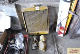 A quantity of Caterpillar D7 spares to include radiator, headlights, magneto and carburettor.NO