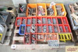 Large quantity of washers and fasteners.