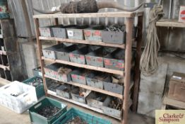 Parts storage rack with large quantity of bins and contents of nails and fasteners.