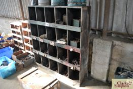 Wooden parts storage unit with various fasteners.