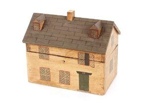 A wooden house shaped tea caddy, 26.5cm long, 20cm