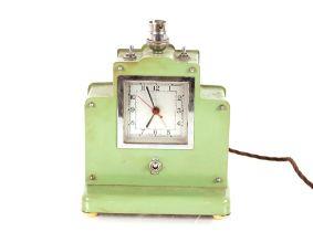 A large Art Deco green metal alarm clock / table l