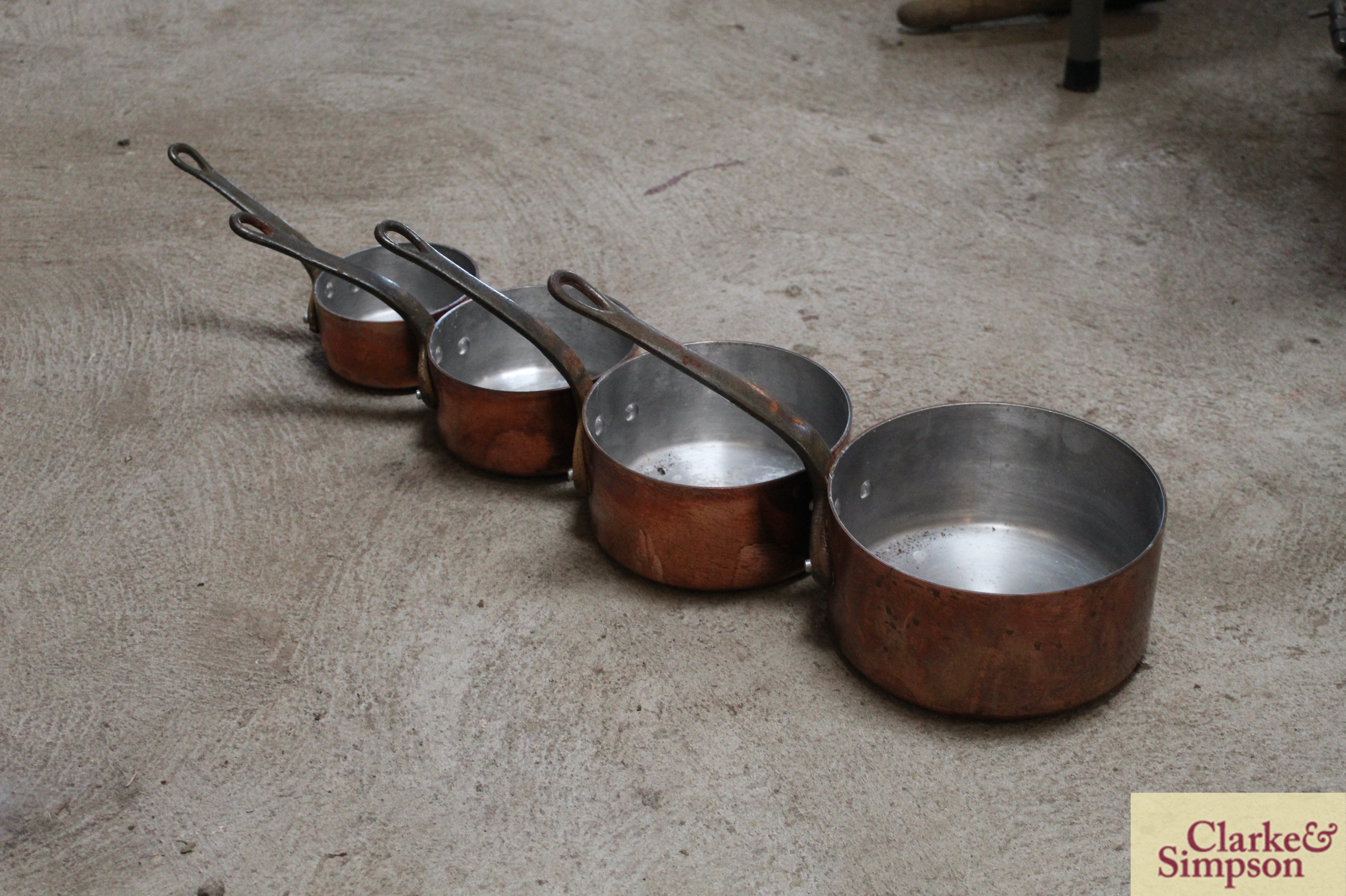 A set of four graduated copper saucepans with iron - Image 2 of 4