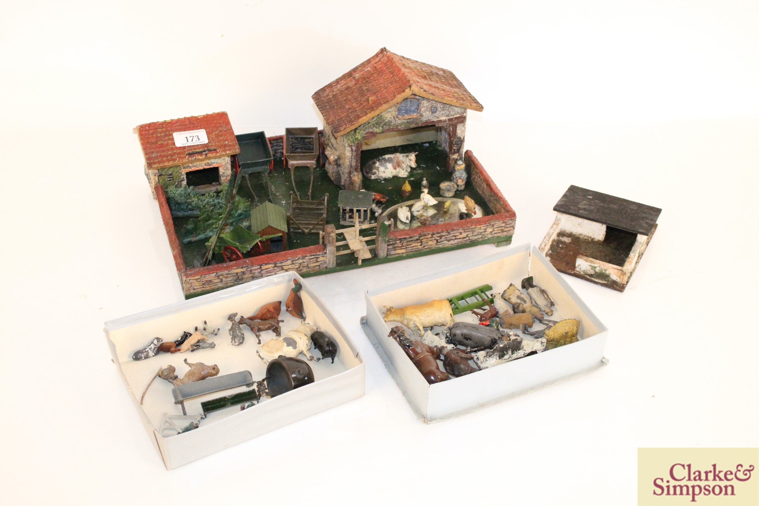 A toy farmyard and a quantity of model lead animals an
