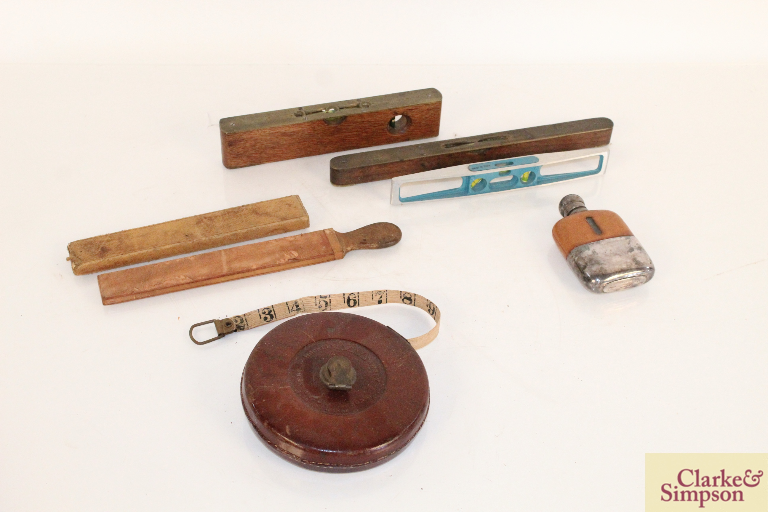 Three various spirit levels, a surveyors tape, a h