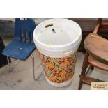 A retro plastic waste bin and a roll of similar design flower wal
