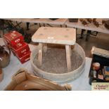 A vintage rustic pine stool and a garden sieve