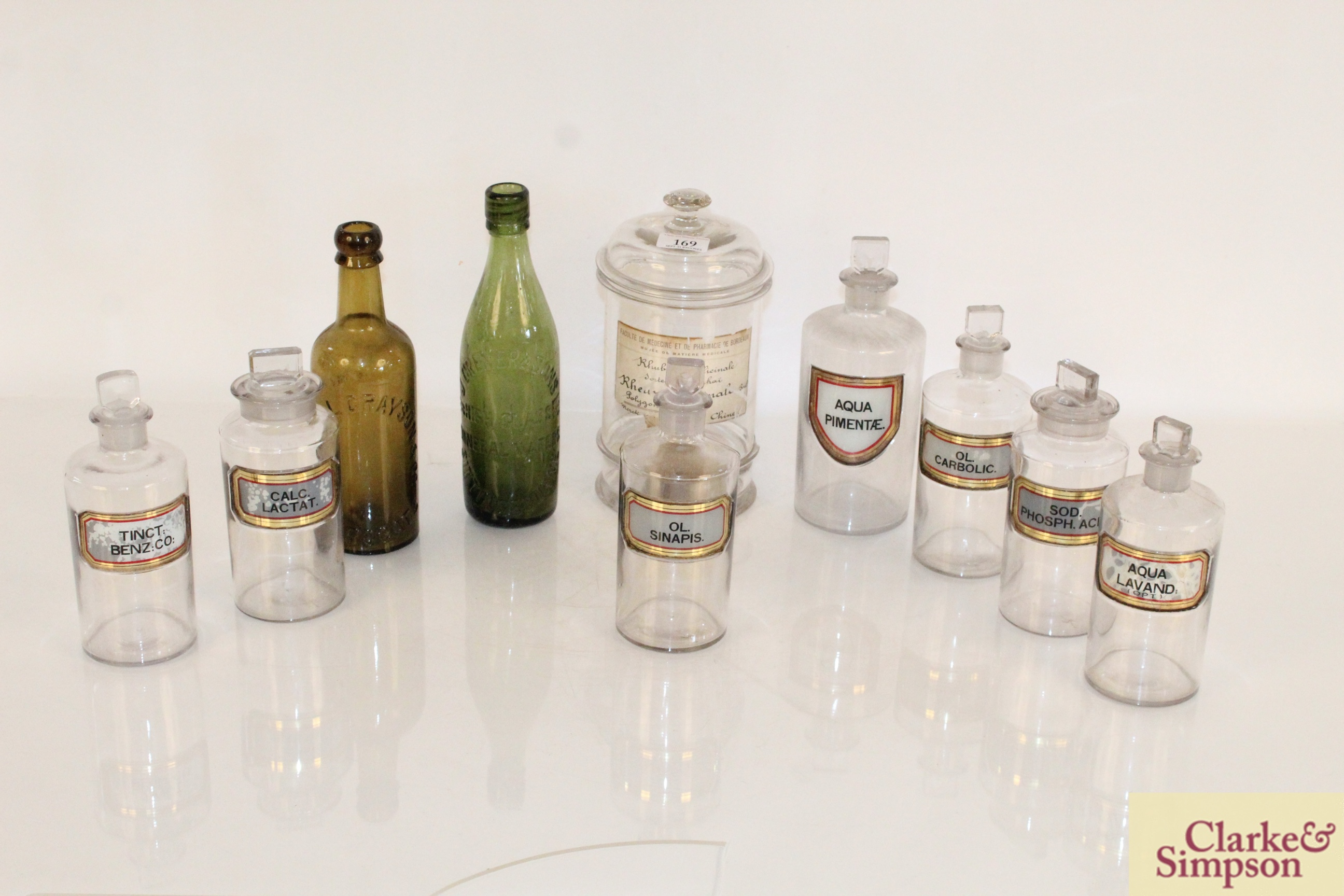 A quantity of various glass chemist jars and two
