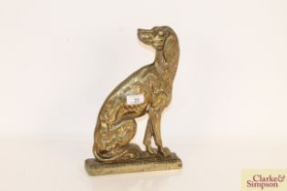 A brass door stop in the form of a seated hound