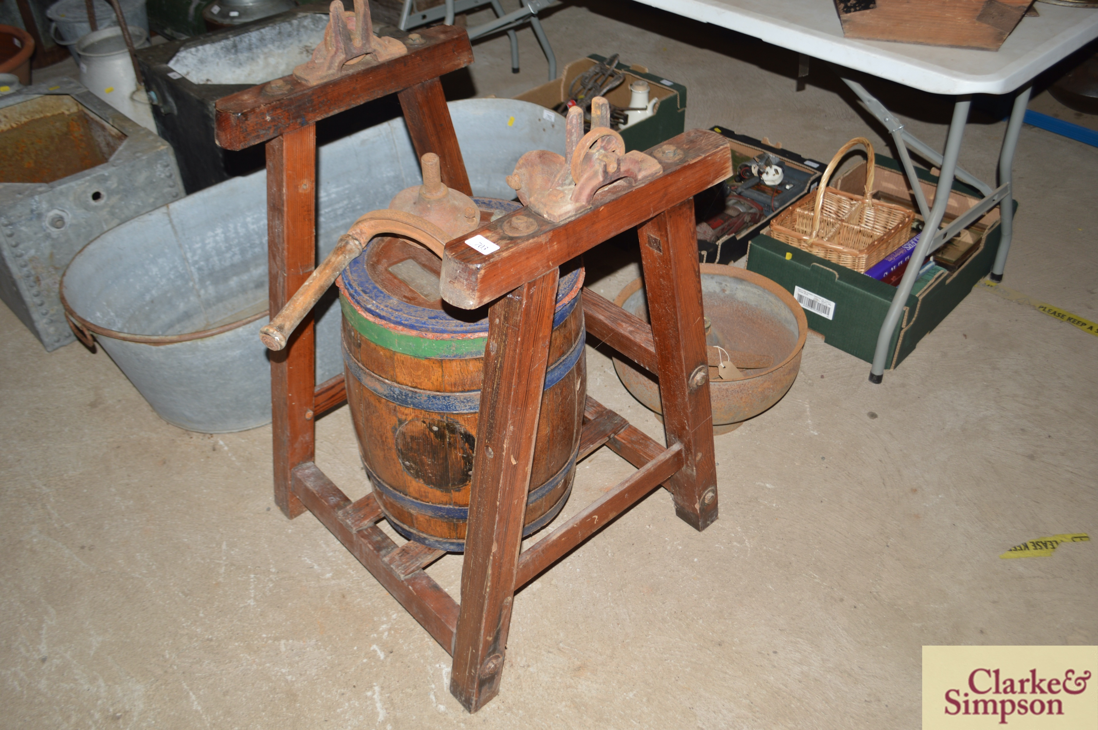 An old butter churn with stand and cream separator