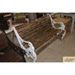 A cast metal and wooden slatted garden bench