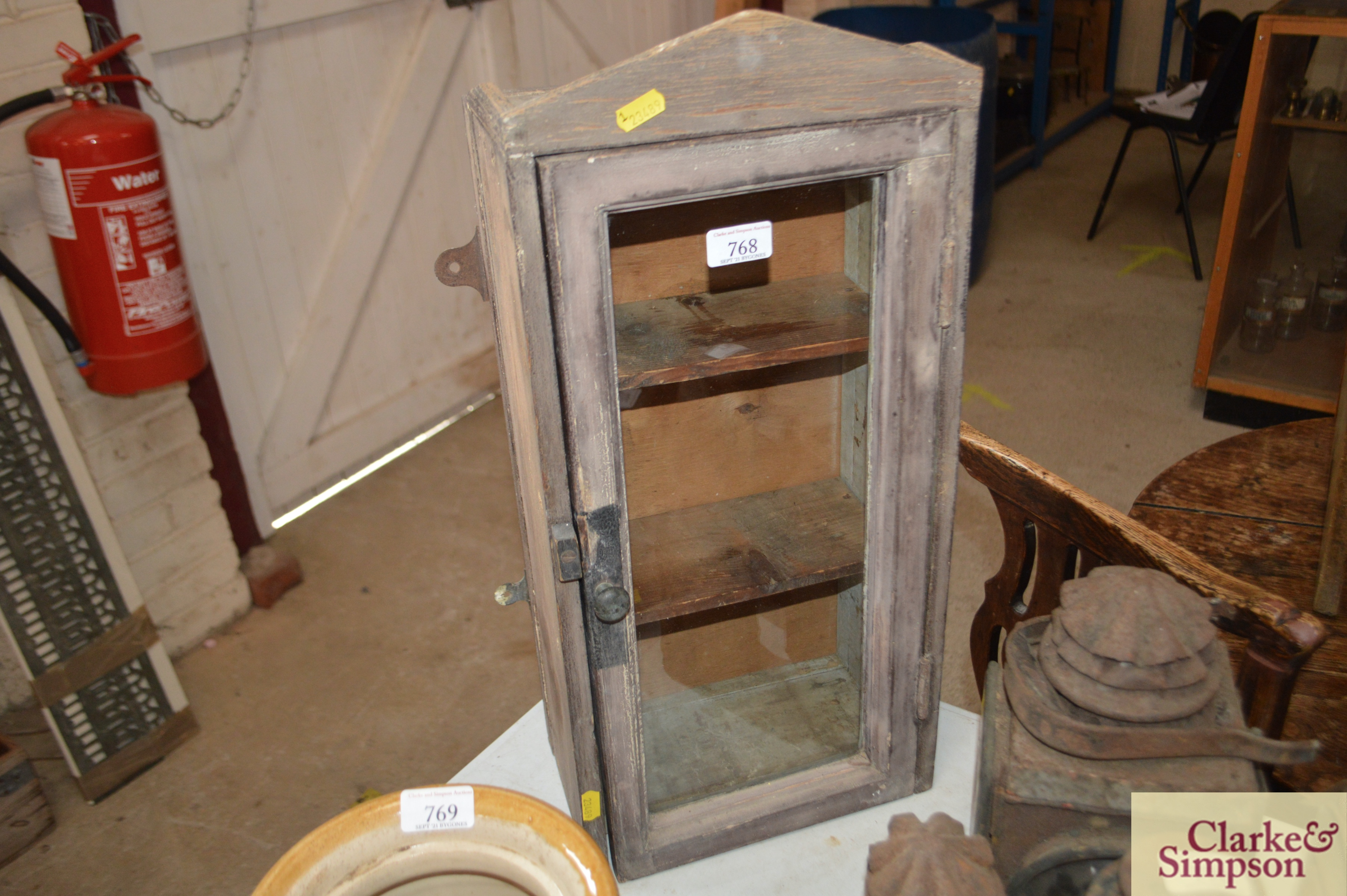 A 19th Century small wall cabinet with interior sh