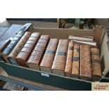 Various antiquarian leather bound books, including