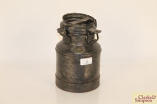 A 2 litre steel and brass mounted churn