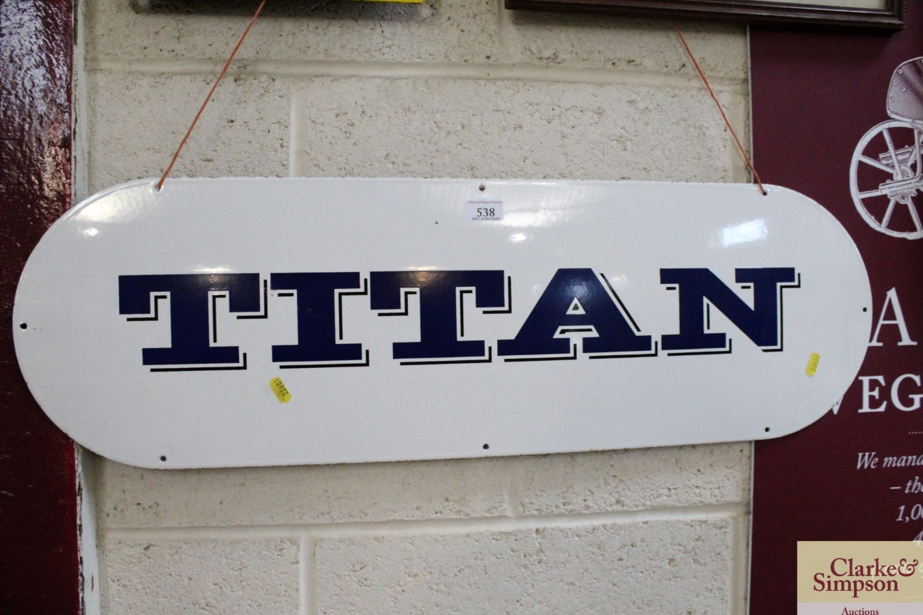 """An oval enamel advertising sign for """"Titan"""", appro"""